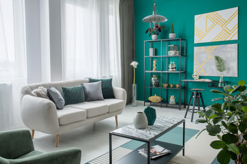 Green cosy living room interior