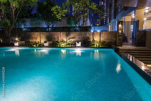 Lighting business for luxury backyard swimming pool. Relaxed ...