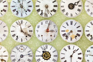 Clock faces in front of retro wallpaper