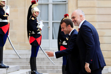 French President Emmanuel Macron escorts Albanian Prime Minister Edi Rama before a meeting at the Elysee Palace in Paris