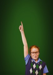 red hair boy touching air on green background