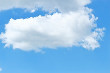 Beautiful white fluffy cumulus clouds floating on a deep blue sky