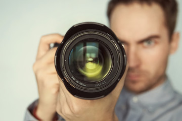 Man taking photo of you with mirrorless camera.