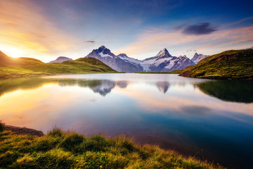 Wall Mural - Great view of the snow rocky massif. Location Bachalpsee in Swiss alps, Grindelwald valley.