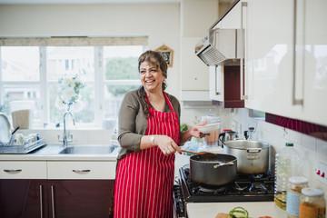 Mature Woman Enjoying Cooking at Home