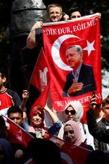 Demonstrators wave flags outside Downing Street ahead of the visit by Turkey's President Recep Tayyip Erdogan, in London
