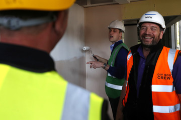 Britain's Prince William joins presenter Nick Knowles and the crew of DIY SOS on a project to build a new community centre in support of those affected by the Grenfell Tower disaster in west London