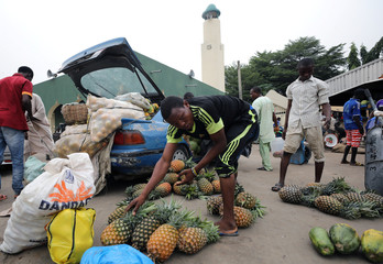 A man arranges pineapples at the Wuse market in Abuja