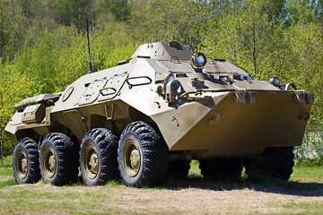 Armored personnel carrier against the forest