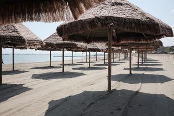 empty umbrellas on the beach of pescara