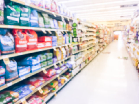 Abstract blurred dog and cat foods, supplies at retail store in USA