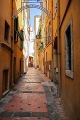 Fotobehang Smal steegje Narrow street with houses in Monaco-Ville, Monaco.