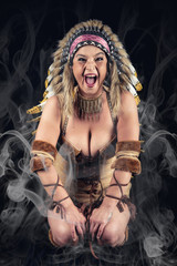 American Indian woman with traditional make up and headdress screaming at camera