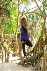 Woman doing asana on balance, back view