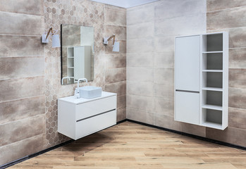 Modern, large washroom with washbasin, mirror and hanging cupboard