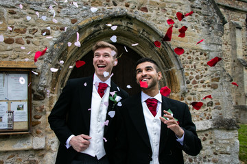 Gay wedding, grooms leave village church after being married to smiles and confetti