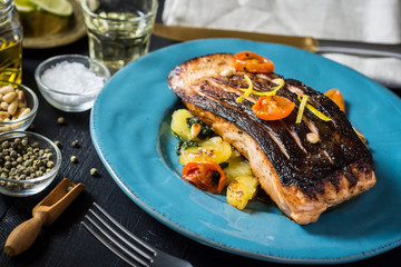 Fresh Grilled Salmon with Vegetables on Blue Plate. Healthy Meal Concept.