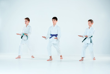The group of boys fighting at Aikido training in martial arts school. Healthy lifestyle and sports concept