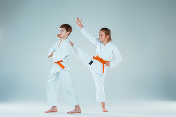 The boy fighting at Aikido training in martial arts school. Healthy lifestyle and sports concept