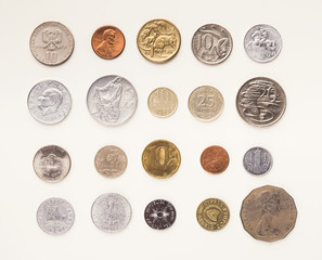Set of coins of different countries on white