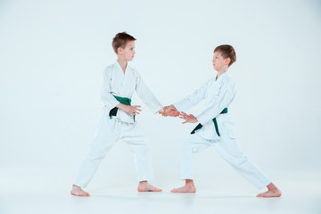 The two boys fighting at Aikido training in martial arts school. Healthy lifestyle and sports concept