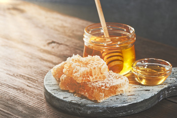 Honey background. Honey with wooden honey dipper on wooden table