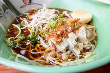 Crispy Pork noodles with egg in big bowl