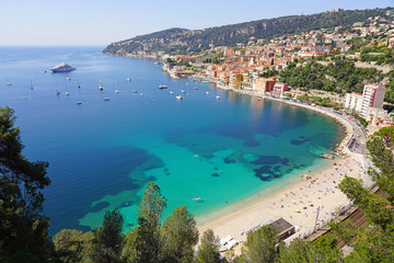 Fond de hotte en verre imprimé Nice Panoramic view of the harbor town of Villefranche sur Mer, a coastal resort city on the Mediterranean Sea on the French Riviera seen from the Corniche
