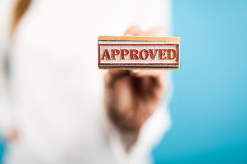 Woman holding Approved stamp