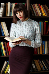 Photo of young brunette with book in hand