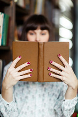 Image of young brunette with book in hand