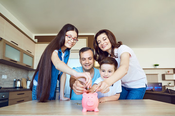 Happy family with pig piggy in the room. The concept of saving in the family.