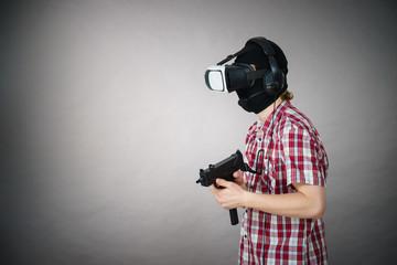 Gamer man wearing VR holding gun