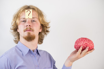 Man playing with human brain