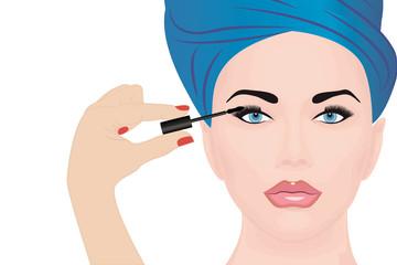 A girl applying mascara on to her eye