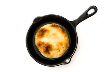 Arepas in frying pan isolated on white background. Venezuelan typical food. Top view