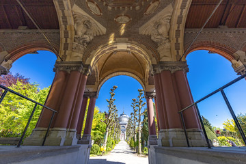 THE HAGUE, 8 May 2018 - Central alley and pathway in the st petrus banden cemetery in The Hague under a shiny sunny blue spring sky, Netherlands