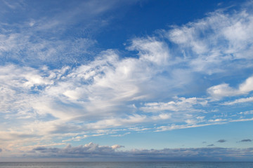 Beautiful sky over the sea with cirrus and small cumulus clouds