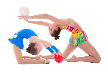 Foto op Canvas Gymnastiek beautiful sporty woman and little girl doing gymnastics with balls isolated on white