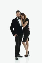 portrait of an elegant woman in a black dress hugging her lover