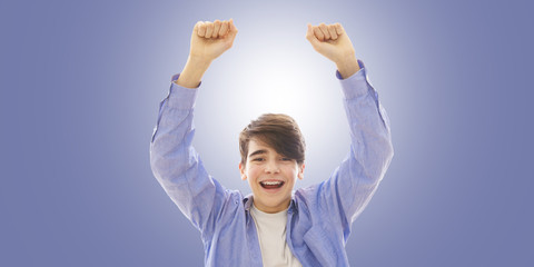 portrait of young man with expression of success and positive celebration
