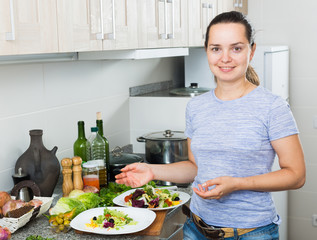 young woman preparing salad
