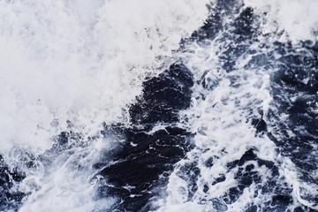 Background shot of aqua sea water surface. Aqua texture background.