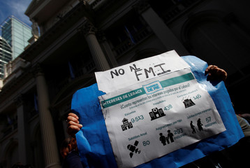 A demonstrator march during a protest against the economic measures taken by Argentine President Mauricio Macri's government in Buenos Aires