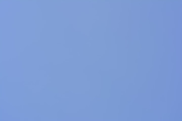Clear blue sky on a sunny day. The azure heaven on springtime day. Blue vastness background.