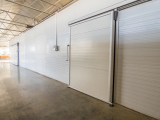 large freezer storage in the factory. closed door from warehouse