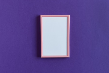 Pink pastel photo frame with white paper card mockup on a ultra violet background