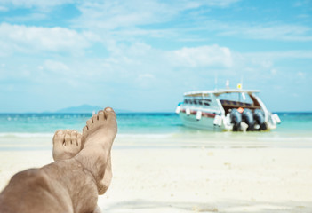 Conceptual picture of relaxing person on an asian beach