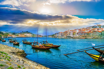 Cityscape over architecture and traditional boats on Rio Douro river in Porto city, Portugal Wall mural