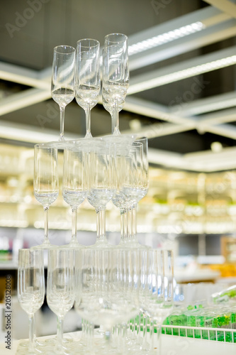 Empty Glasses In Pyramid Or Tower On Table At Wedding